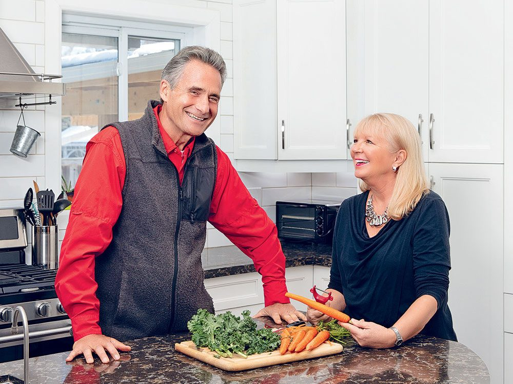 The founders of Thrive for Good stand at their kitchen counter.