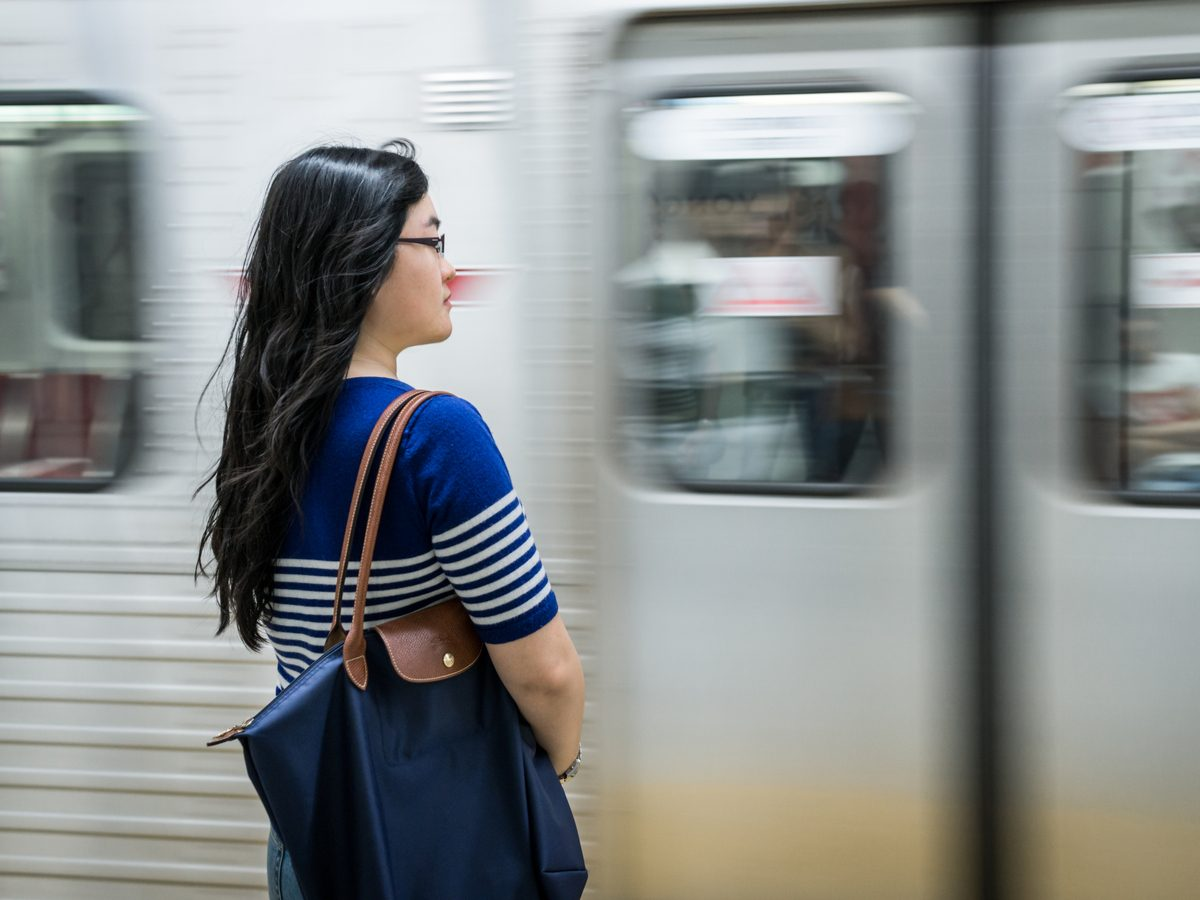 Woman waiting for the subway in Toronto