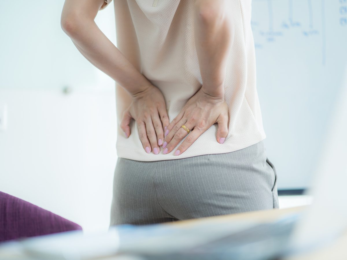 Woman experiencing back pain