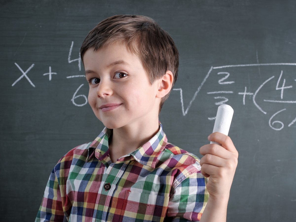 Young boy solving math equations