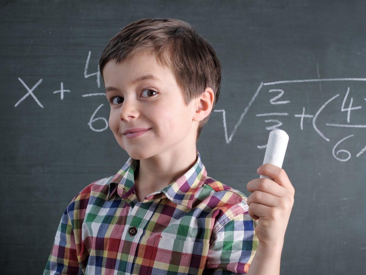 Young boy solving math equations