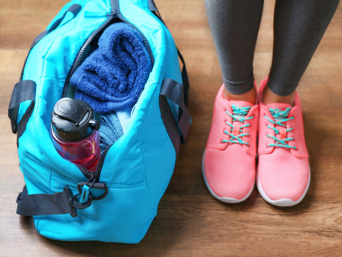 Close-up of gym bag and woman's trainers