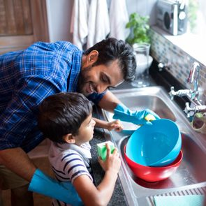 Healthy home checklist - Father and son cleaning dishes in the kitchen