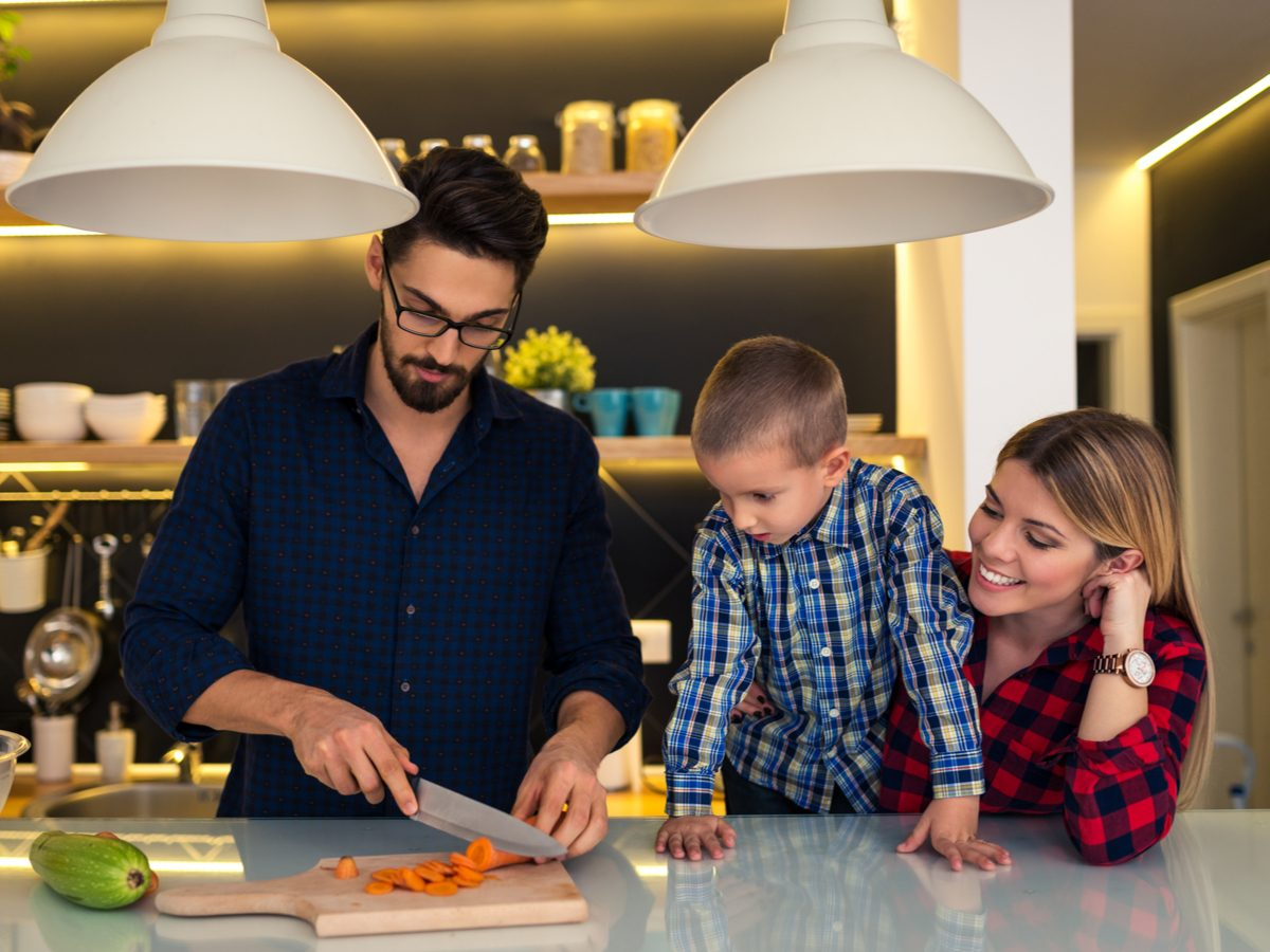 Family preparing food together in the kitchen