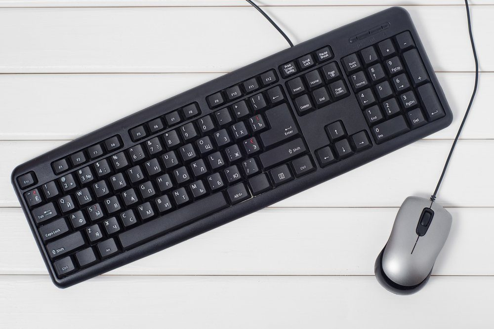 Keyboard mouse from computer on white wooden background isolation