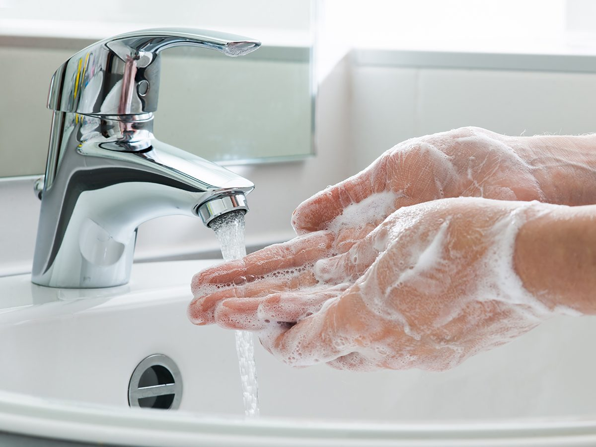 Washing hands with soap and water