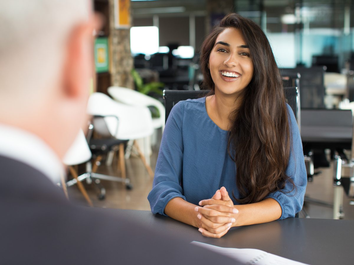 Smiling woman at job interview