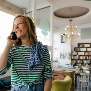 woman on smiling on the phone with a friend
