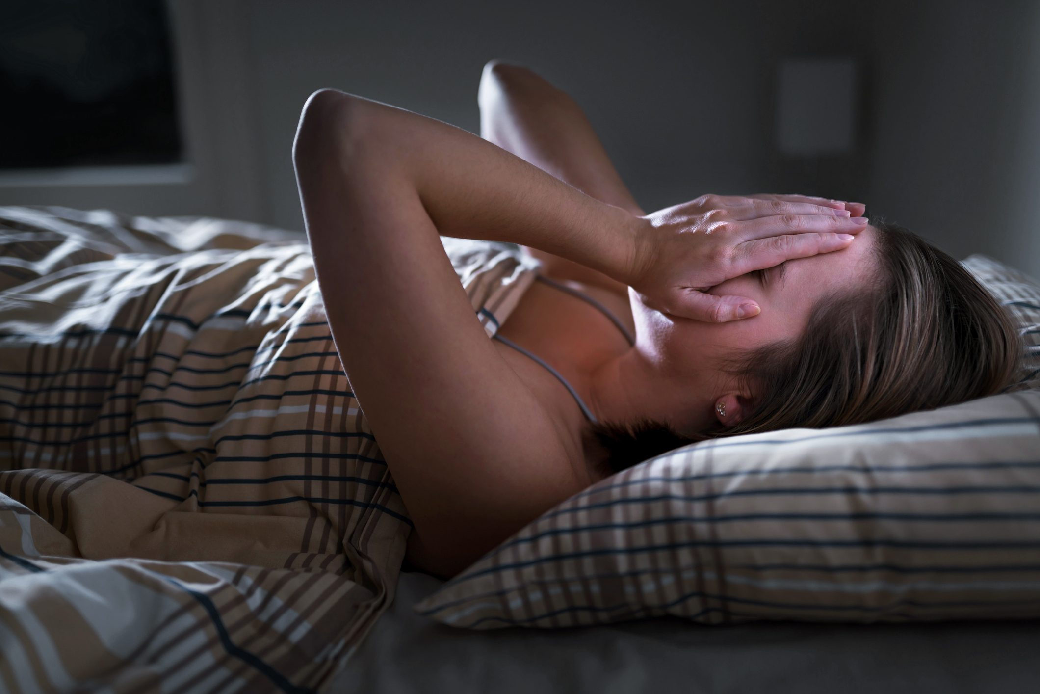 woman struggling with sleeping and insomnia