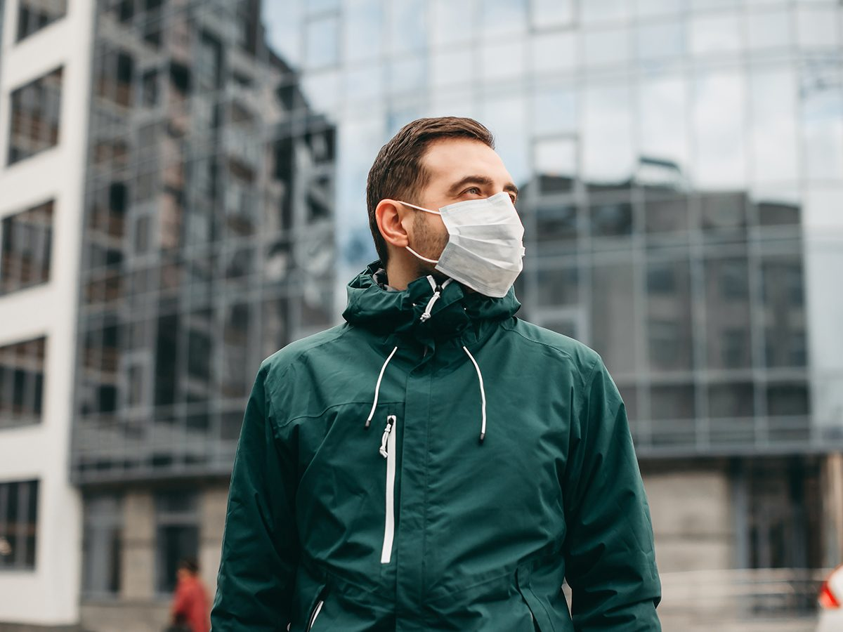 Man wearing a face mask outside on street