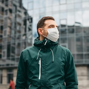 Man wearing a face mask outside on street