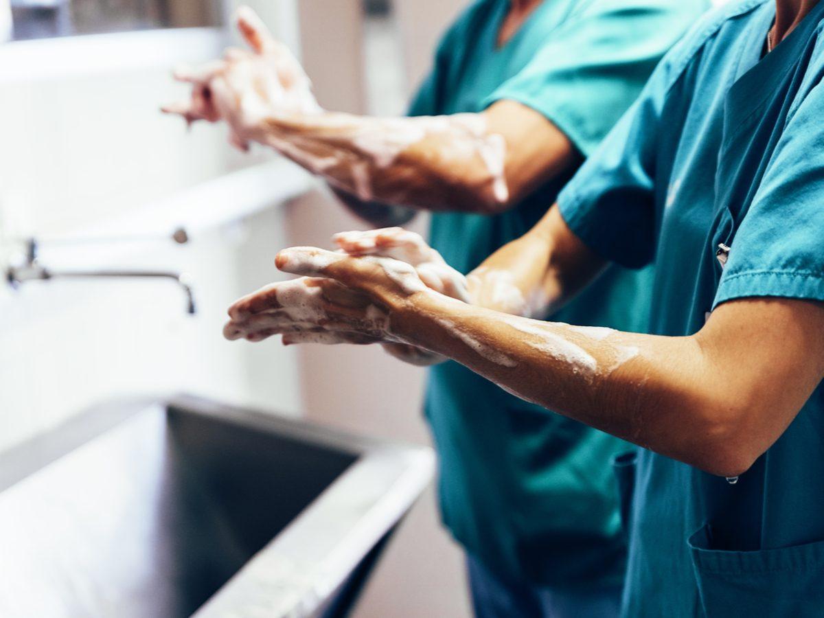 Nurses washing their hands at sink