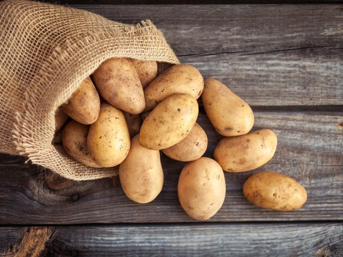 Potatoes on rustic table setting