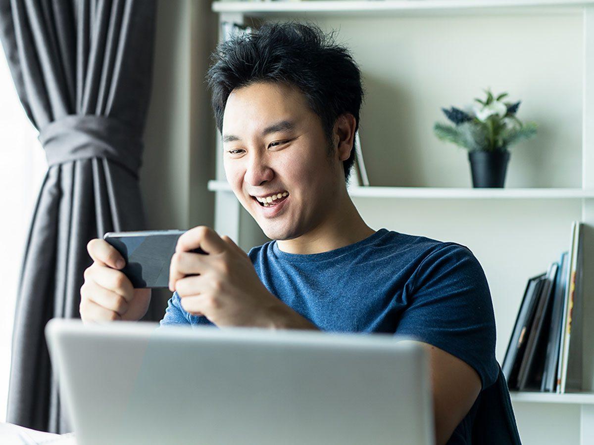 Man playing game on phone.