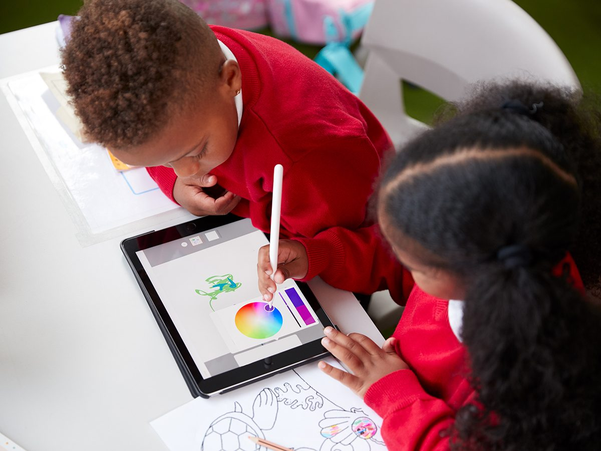 Quarantine activities for kids - kids drawing on tablet