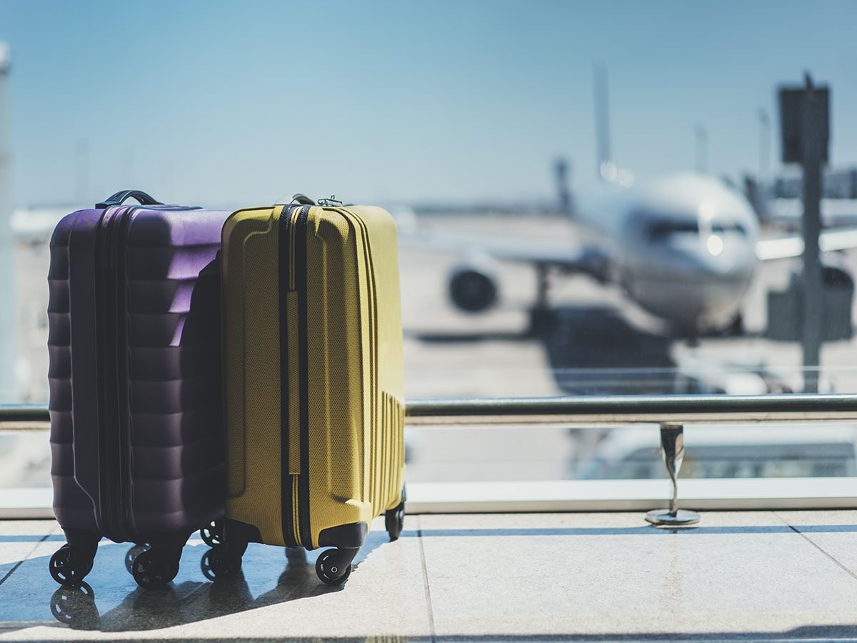 two suitcases at an airport terminal.