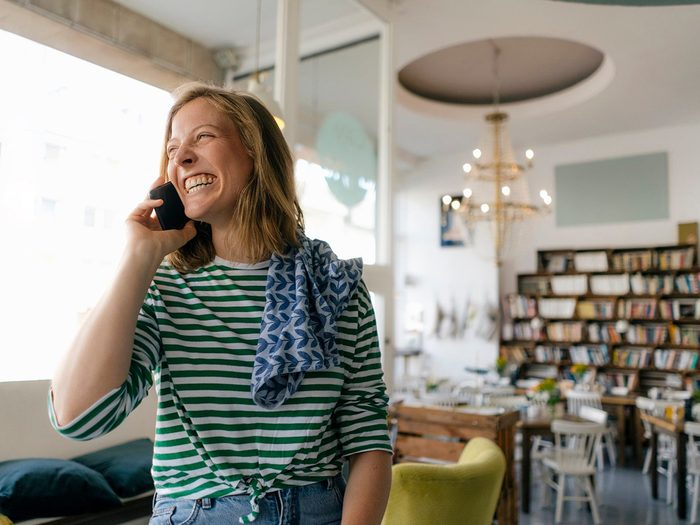 Wake Up Happier - Woman talking on the phone and smiling