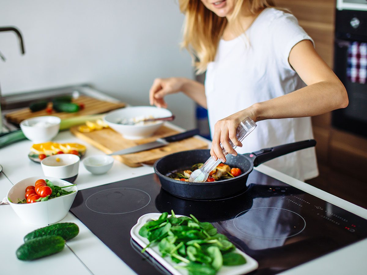 women cooking vegetables at home.