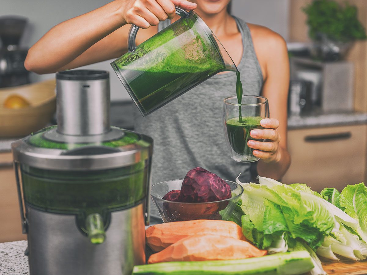 Women Making Green Juice With Mixer