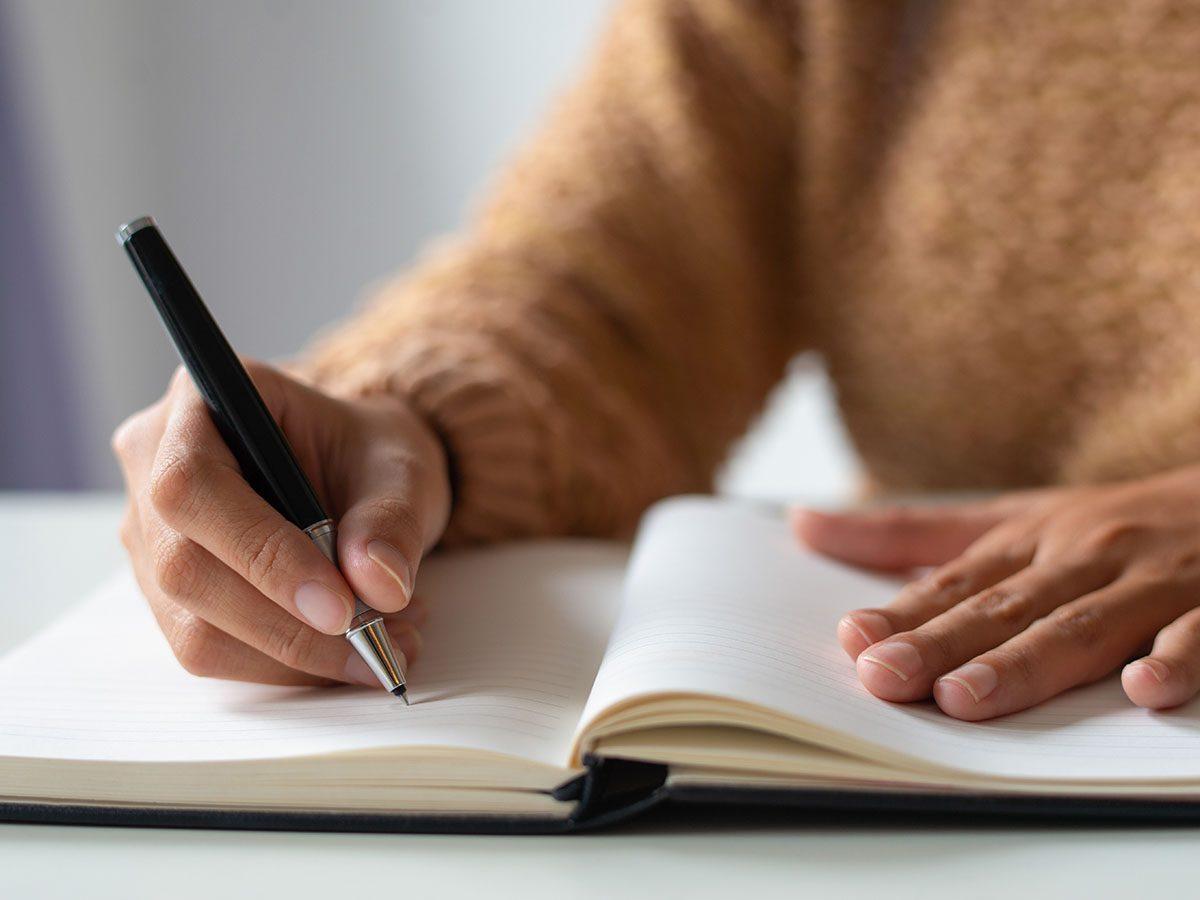 Women writing in journal
