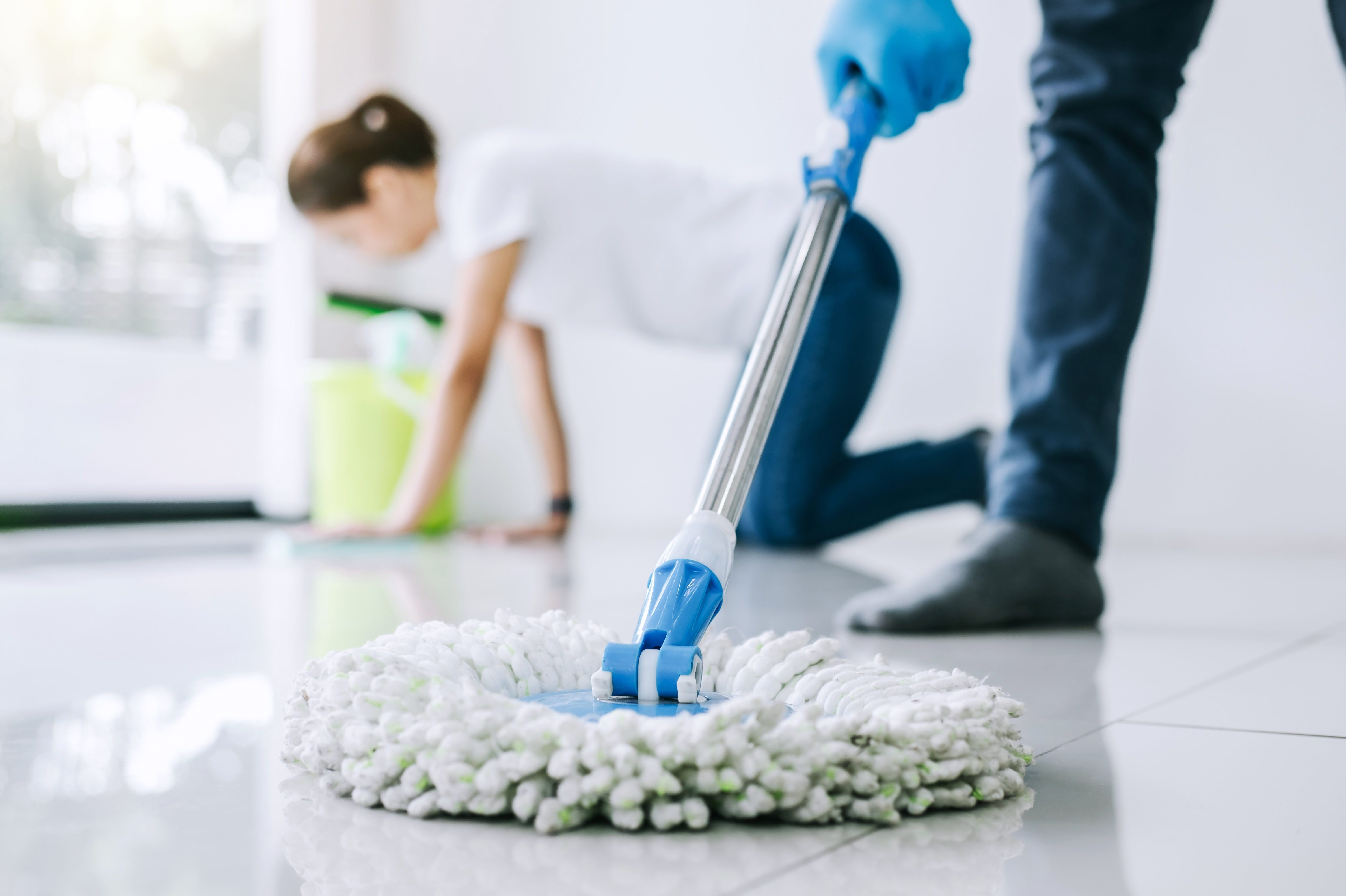 Low Section Of Man Cleaning Floor With Mop