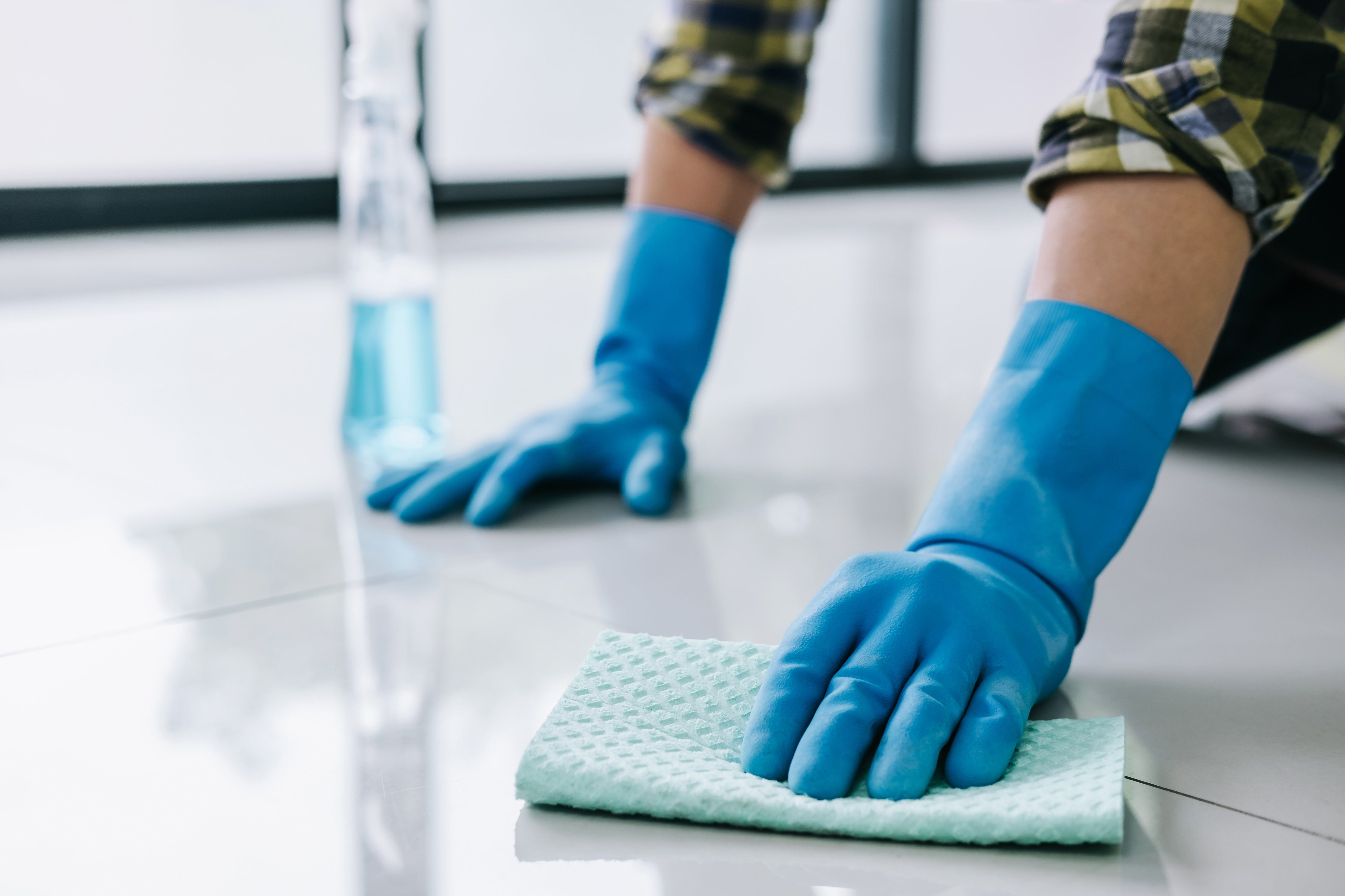 Close-Up Of Man Cleaning Floor At Home