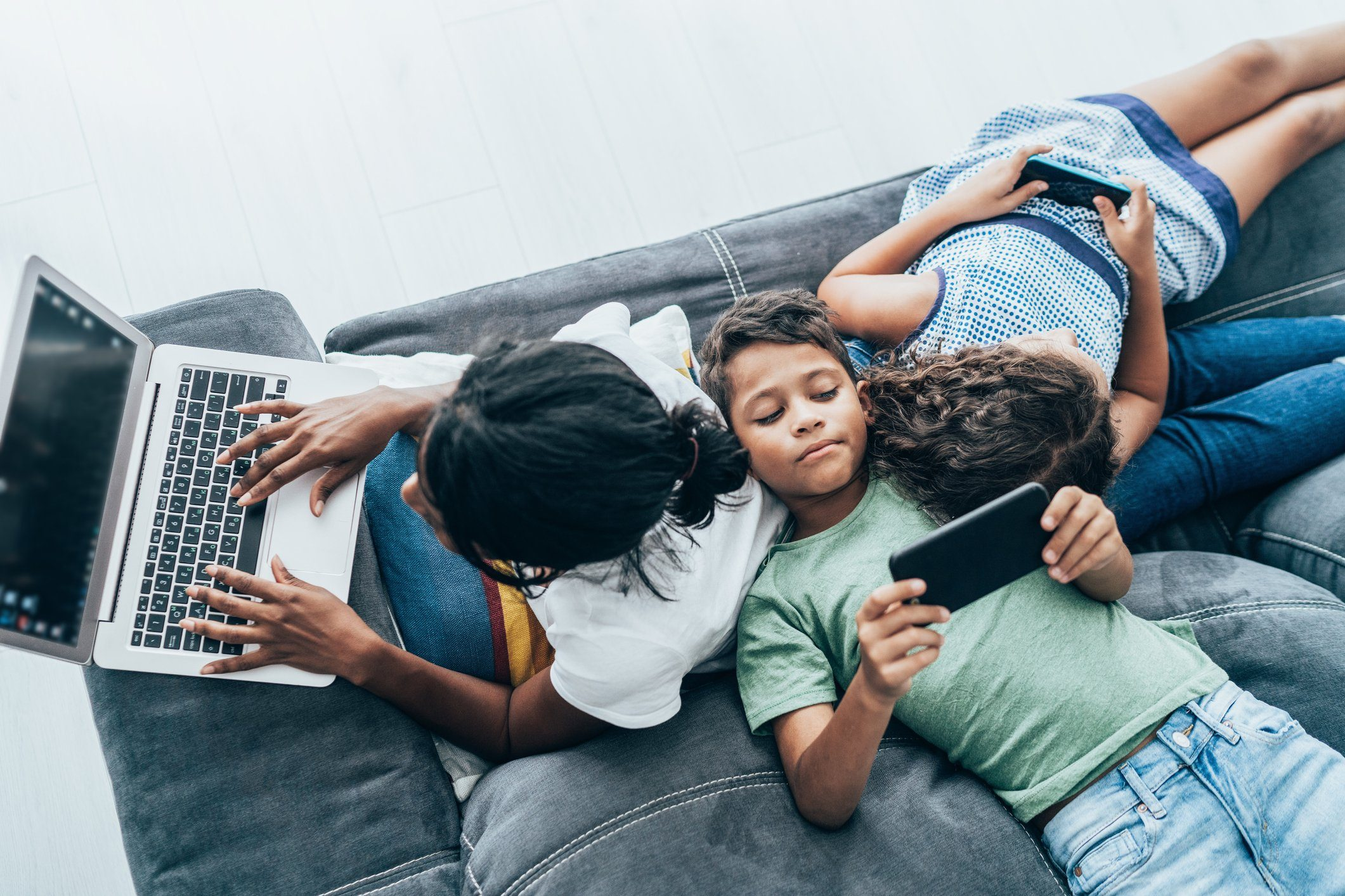 Mixed race family with digital devices