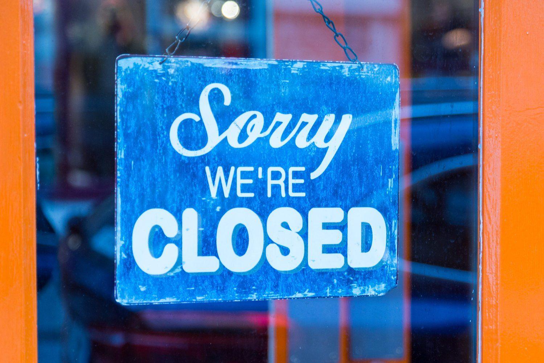 Closed sign in shop door