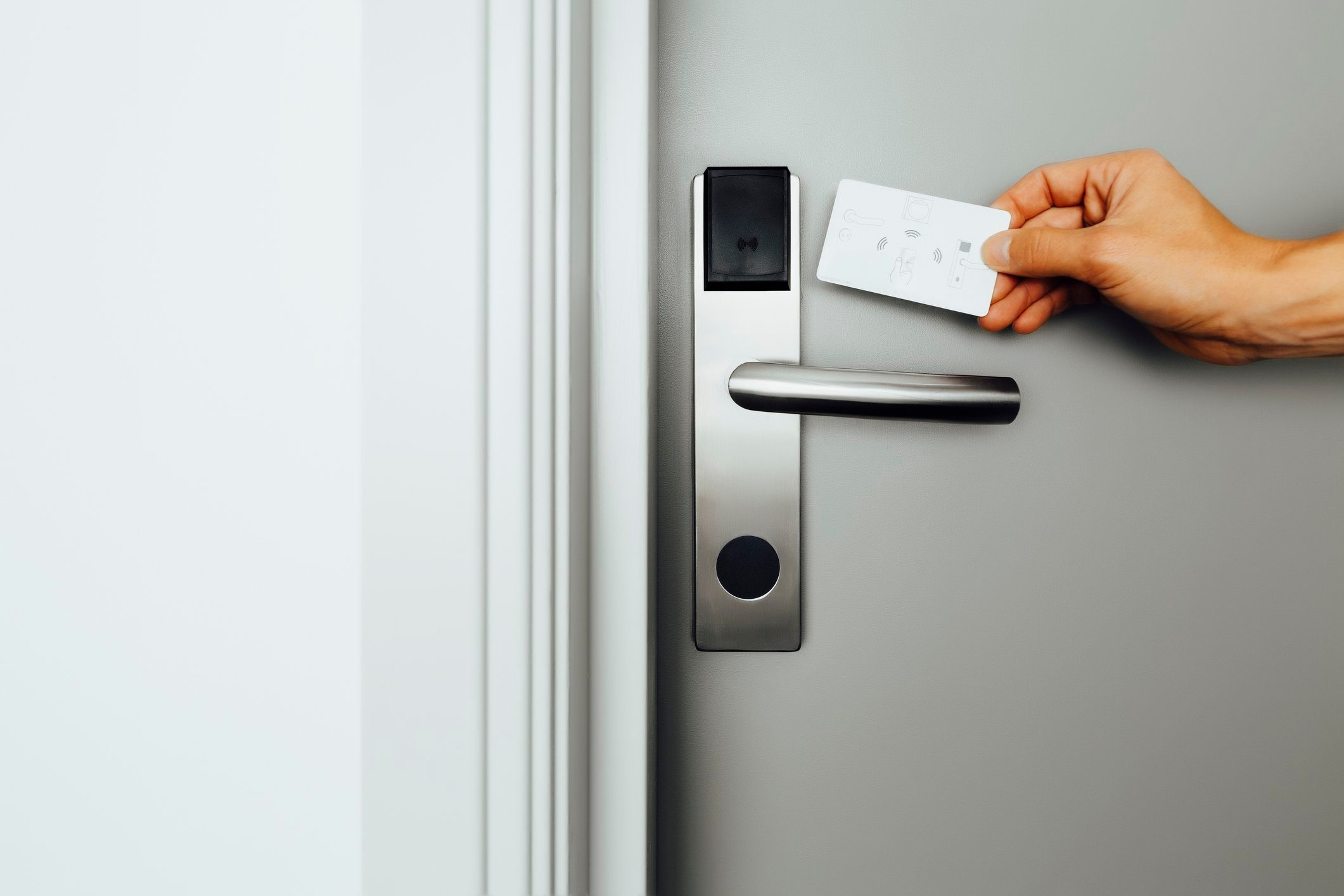 Entering a hotel room with electronic lock and keycard