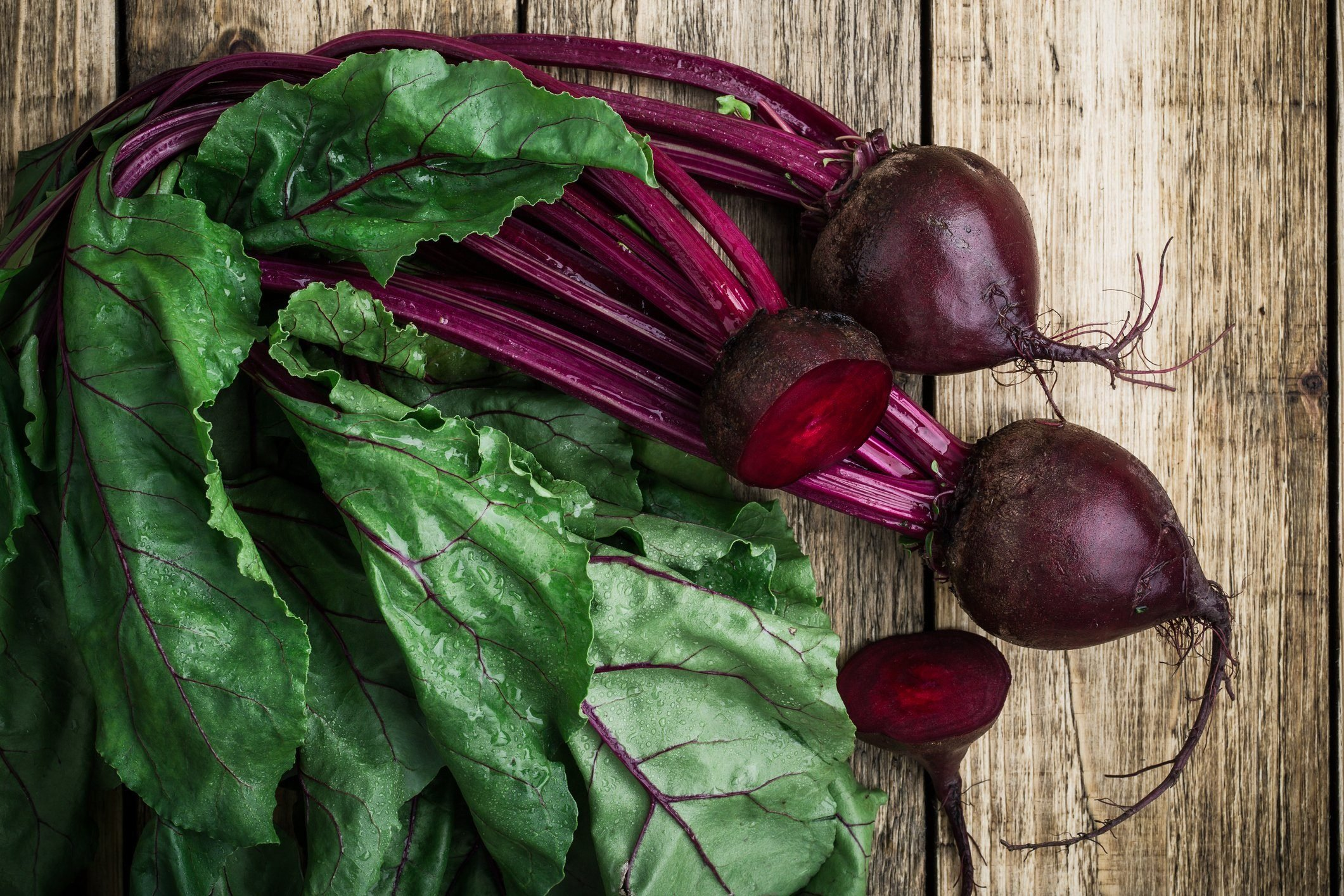 Fresh organic beetroot over wooden background