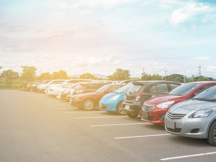 Beat summer heat - parking lot filled with parked cars