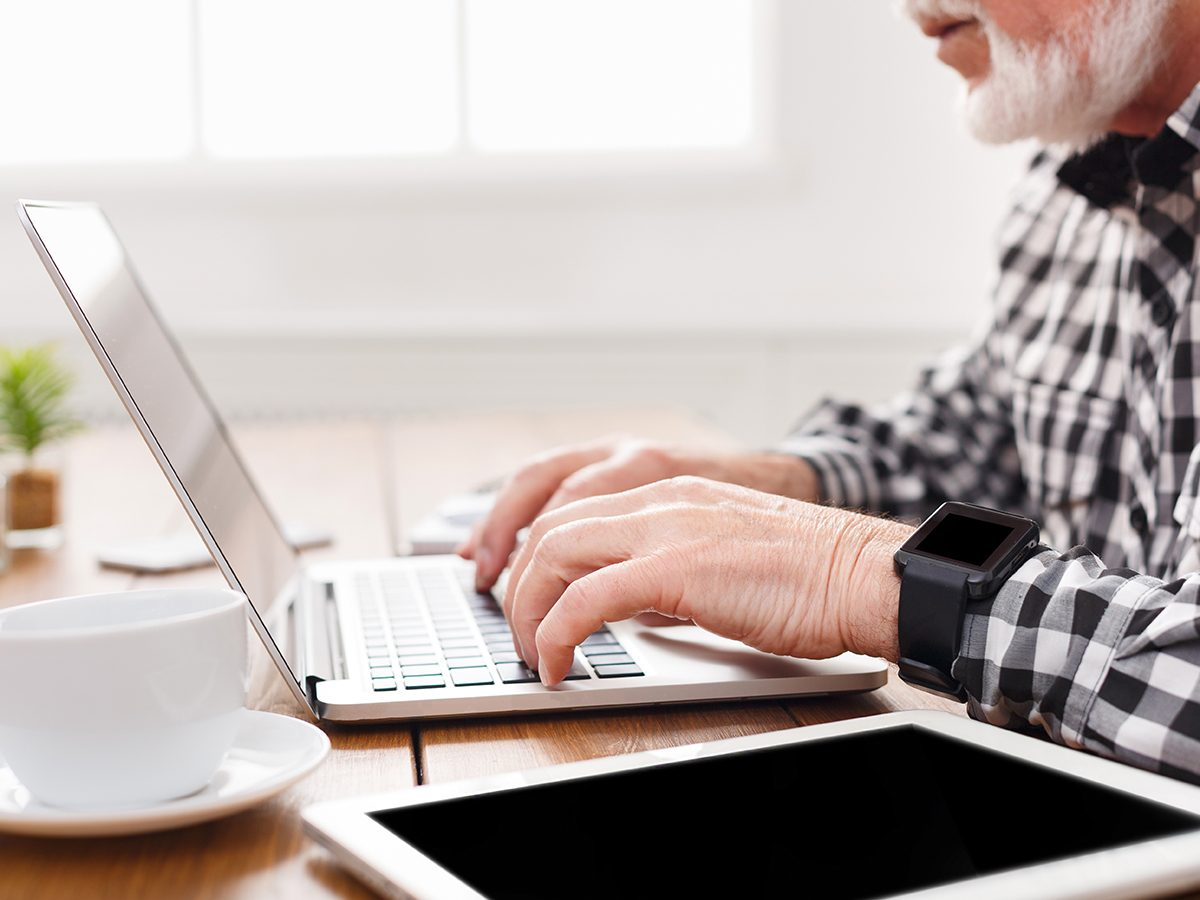 Caring for aging parents - senior on laptop