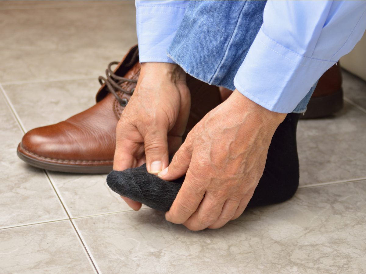 Businessman with aching feet