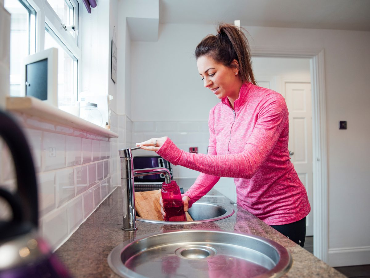 Filling reusable water bottle