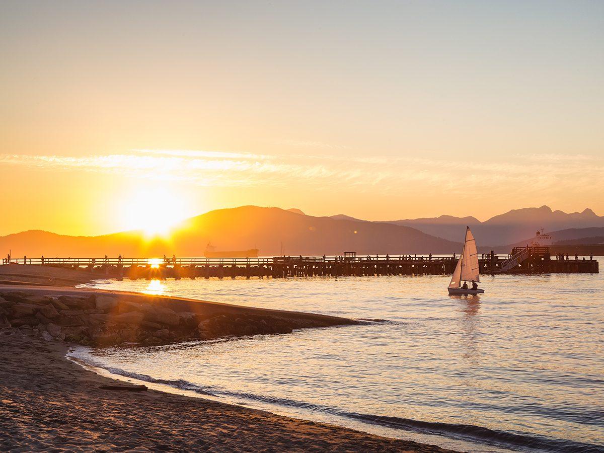 Summer forecast 2020 - British Columbia beach with sailboat