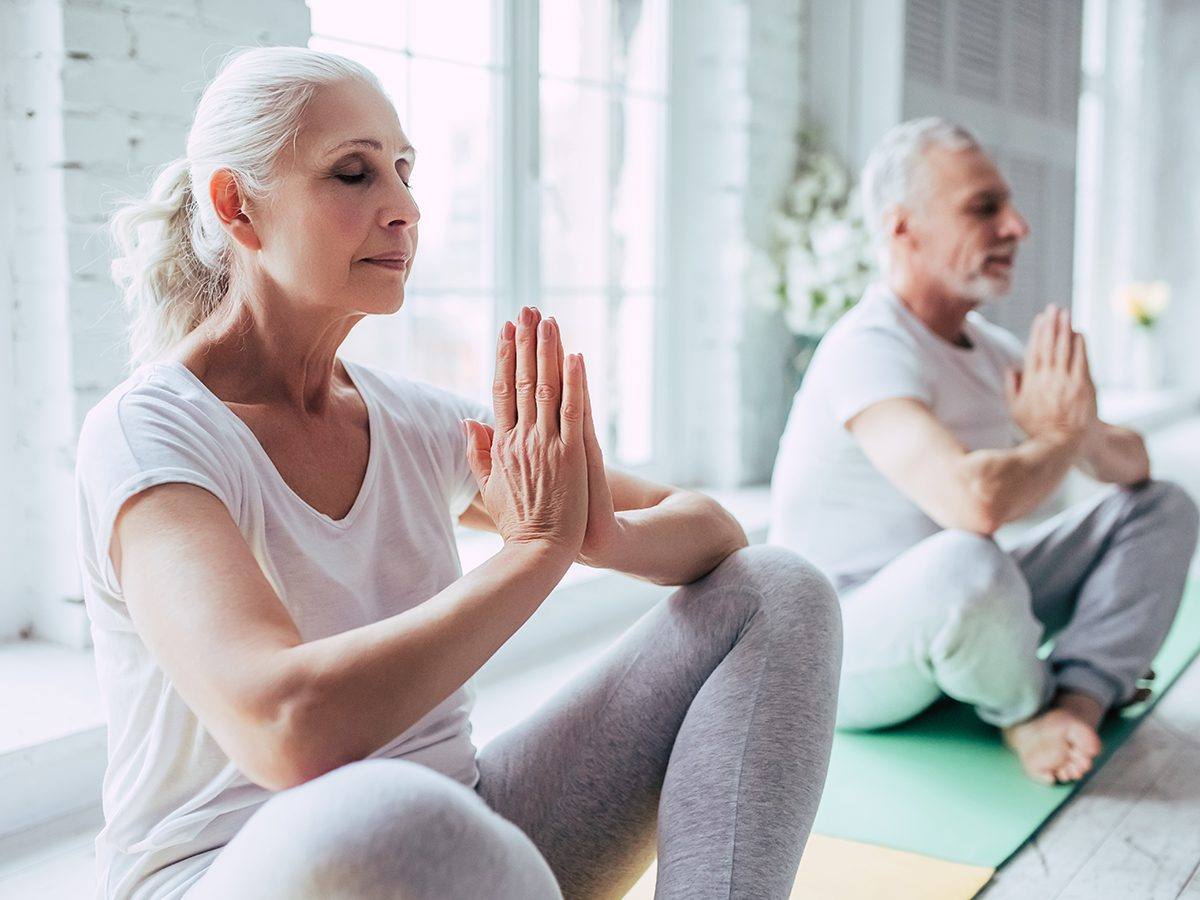 Things that slow down aging - senior couple meditating