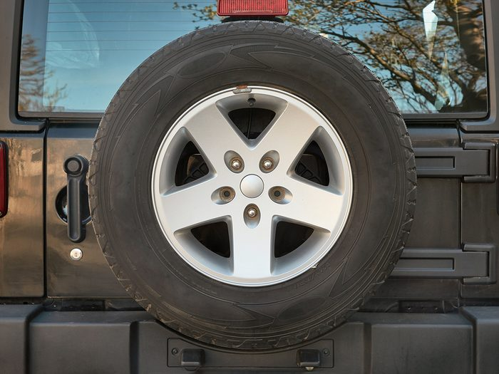vintage car features - spare tire mounted on jeep