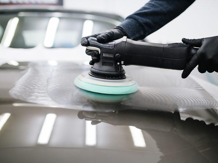 car wax facts - waxing car with orbital polisher