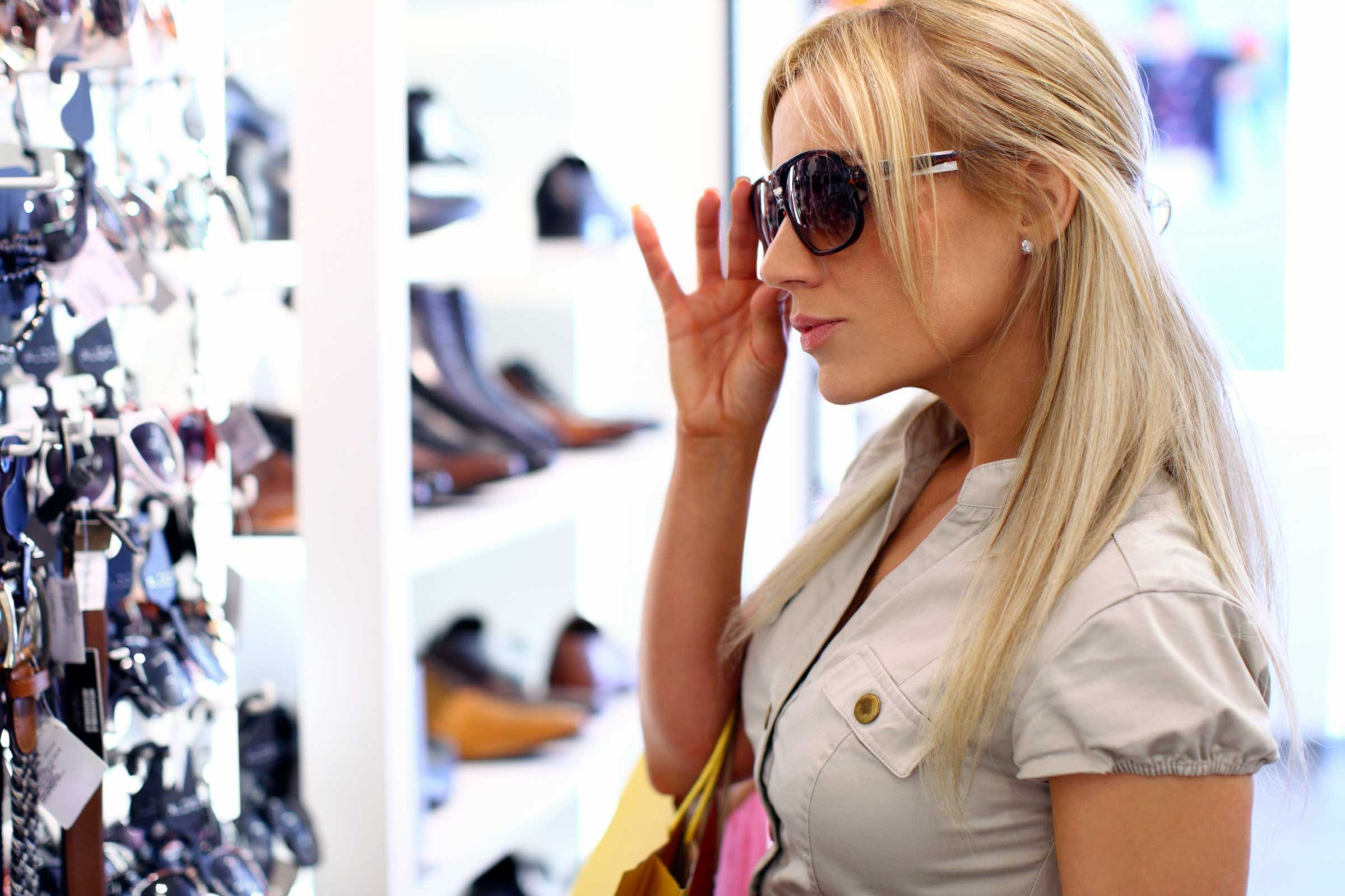 woman trying on sunglasses