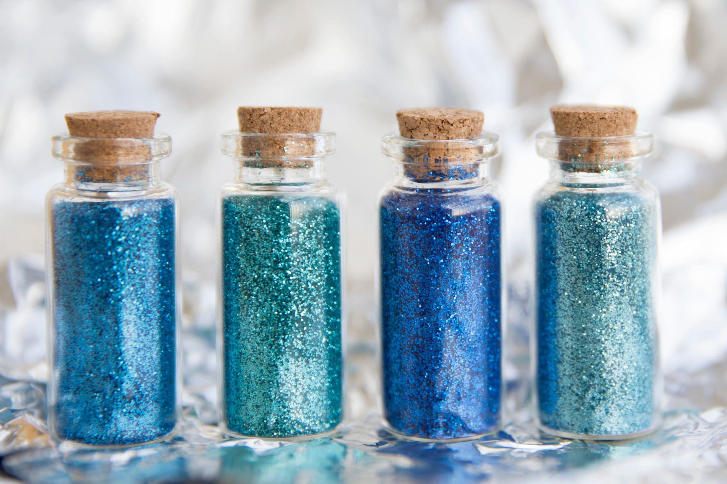 Close-Up Of Glitter Bottles On Table