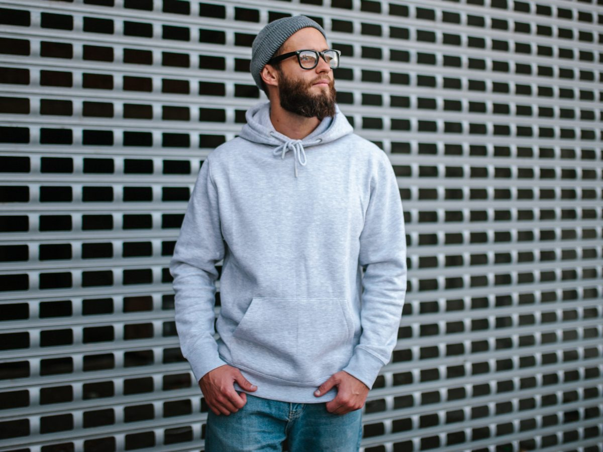 Millennial wearing a hoodie sweatshirt