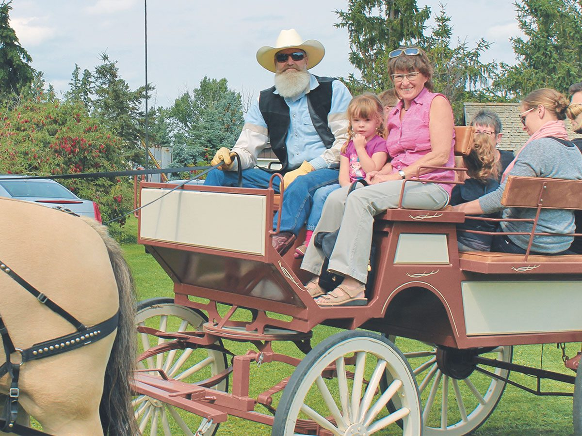 Far left: Alexa and Gramma Linda on a wagon seat with the driver