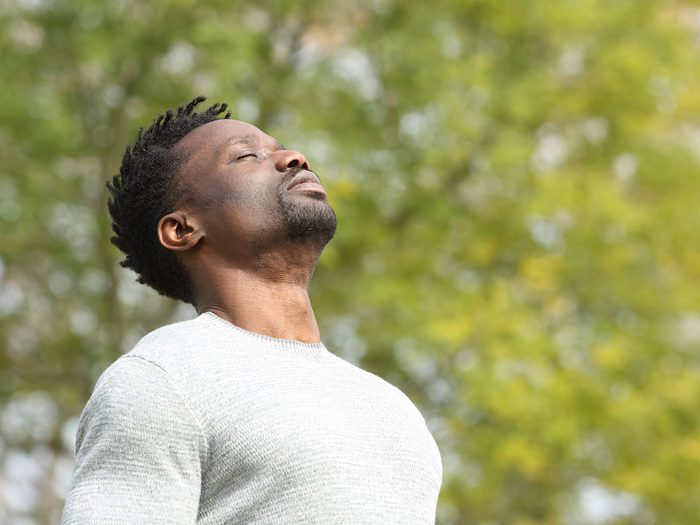 Home remedies for nausea - man deep breathing