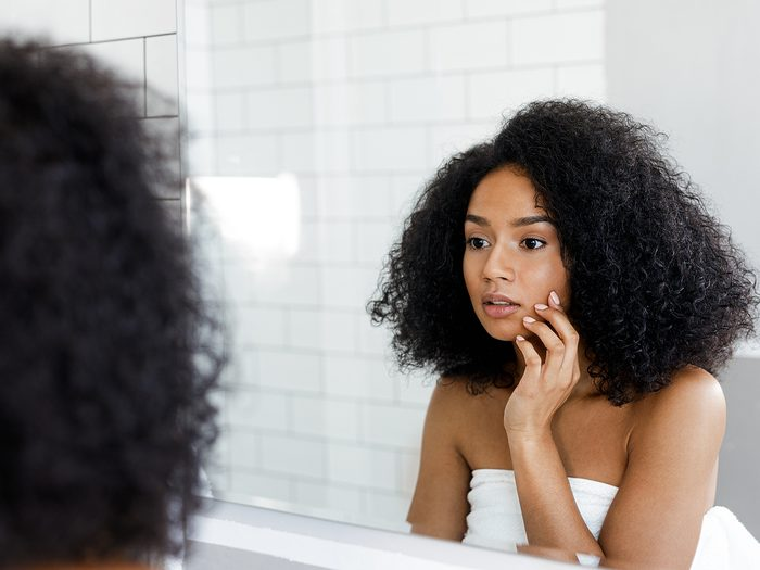 Medical trivia - woman inspecting her reflection in mirror