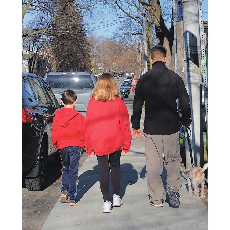 The Rempel family walks Penny