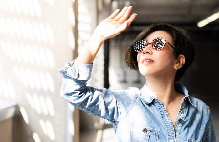 Sunglasses myths - Woman wearing stylish sunglasses