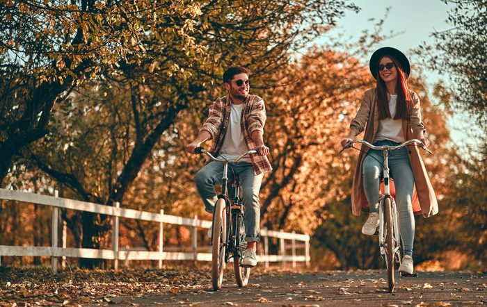 Sunglasses myths - Couple riding bicycle in fall