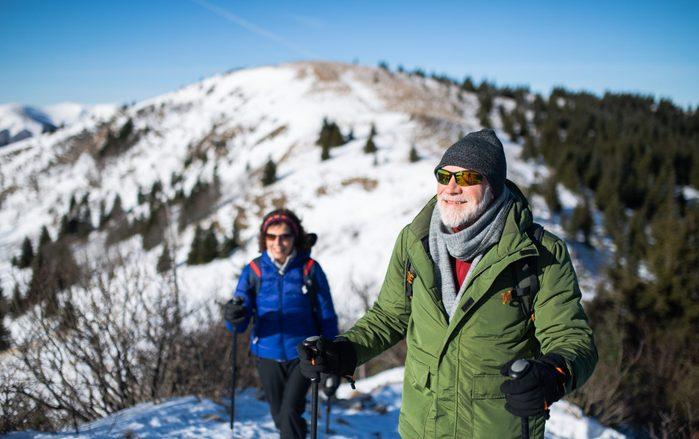Sunglasses myth - Senior couple nordic walking in winter
