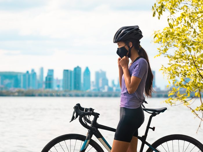 Summer Canada 2021 forecast - Montreal woman on bike in mask