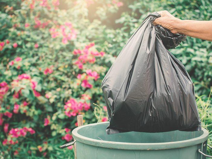 Throwing Garbage Bag Into Trash Can